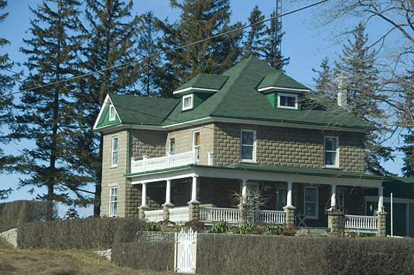 beautiful grey and green roof house at historical hamilton