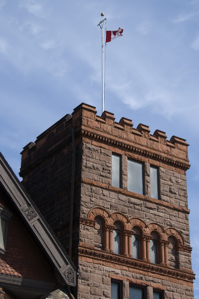 Red Stone Tower With Flag At Historical Hamilton